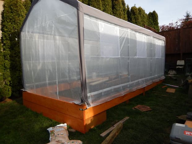 The Unlevel Ground Wood Greenhouse Design