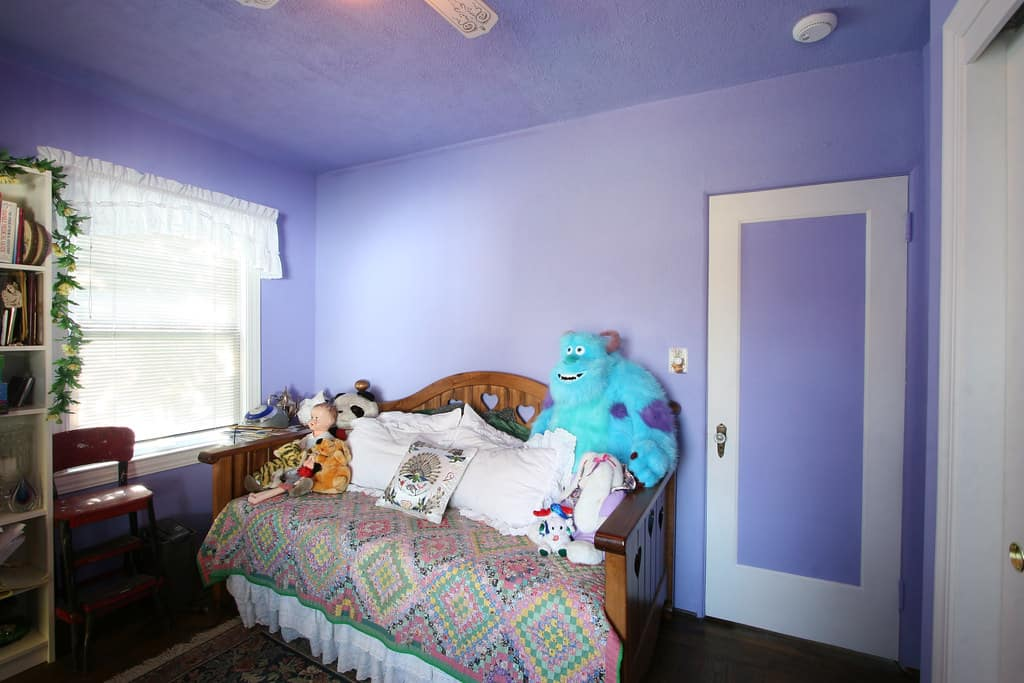 purple wall bedroom with white trim